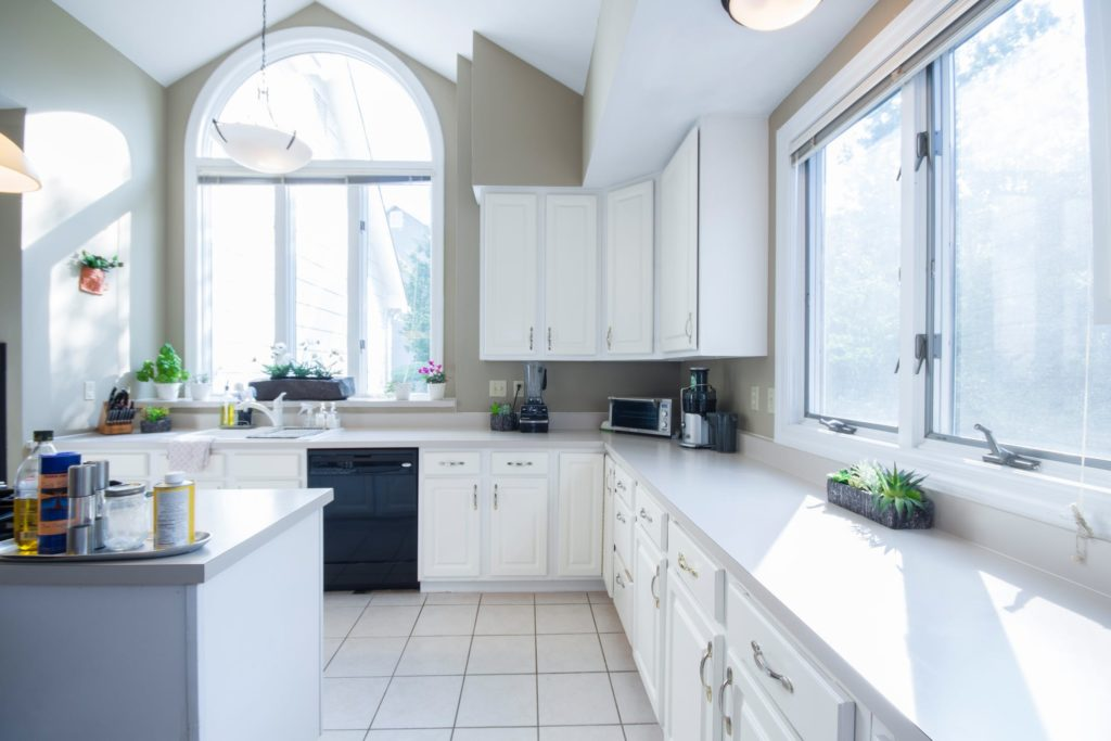 Cleaning a kitchen before a staging.