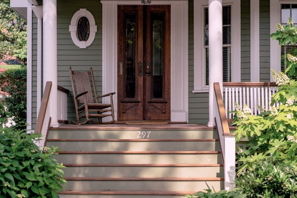 Cleaning a porch before a staging.